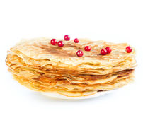 Pancakes with berries on a white plate Stock Images