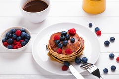 Pancakes with berries Stock Images