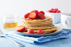 Pancakes with berry and honey Royalty Free Stock Image