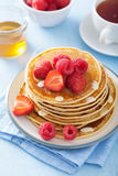 Pancakes with berry and honey Stock Image