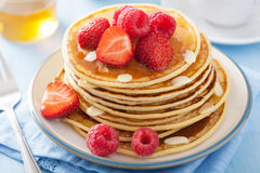 Pancakes with berry and honey Stock Photos