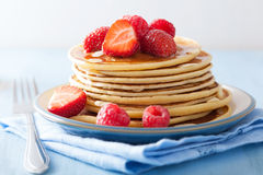 Pancakes with berry and honey Royalty Free Stock Images