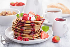 Pancakes with berry and jam Stock Photo
