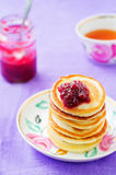 Pancakes with berry jam Stock Photos