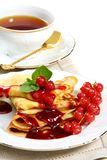 Pancakes with berry sauce. Royalty Free Stock Images