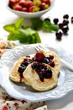 Pancakes with berry topping Stock Photo