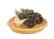 Pancakes with black caviar Royalty Free Stock Photography