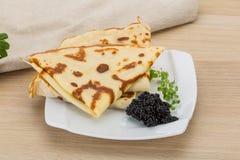 Pancakes with black caviar Stock Photos
