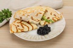 Pancakes with black caviar Royalty Free Stock Image