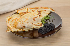 Pancakes with black caviar Stock Photography