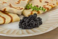 Pancakes with black caviar Stock Photography
