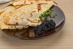 Pancakes with black caviar Stock Photo