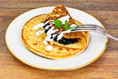 Pancakes with Black Caviar Stock Images