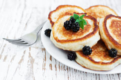 Pancakes with blackberries Stock Images