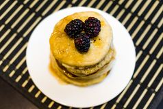 Pancakes with blackberry Stock Images