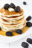 Pancakes with blackberry and maple syrup. Stack of old-fashioned american pancakes with blackberry and maple syrup royalty free stock photo