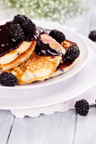 Pancakes and Blackberry Sauce Royalty Free Stock Images