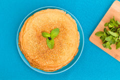 Pancakes on a blue background Stock Photo
