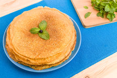 Pancakes on a blue background Stock Photos