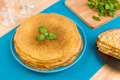 Pancakes on a blue background Royalty Free Stock Images