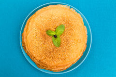 Pancakes on a blue background top view Stock Photography
