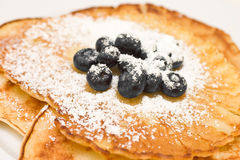 Pancakes with blueberries. Sugared pancakes with fresh blueberries stock photo