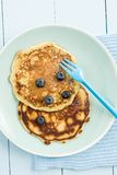 Pancakes with blueberries. On a blue plate royalty free stock image