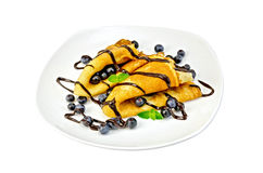 Pancakes with blueberries and chocolate in a plate Royalty Free Stock Images