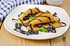 Pancakes with blueberries and chocolate syrup Royalty Free Stock Image