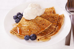 Pancakes with Blueberries Cream and Maple Syrup stock photos