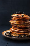 Pancakes with blueberries on the dark wooden table Stock Photos