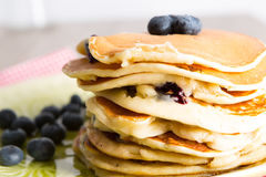 Pancakes. With blueberries on a dish stock image