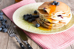 Pancakes. With blueberries and maple syrup royalty free stock image