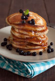 Pancakes with blueberries and maple syrup Royalty Free Stock Photos