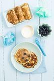 Pancakes with blueberries. And milk on blue background royalty free stock photos