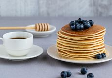 Pancakes with blueberries on a neutral background. stock images