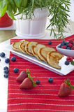 Pancakes with blueberries and raspberries. On square plate Royalty Free Stock Images