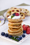 Pancakes with blueberries and raspberries. Breakfast Royalty Free Stock Photo