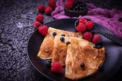 Pancakes with blueberries and raspberries. Selective focus Stock Photo