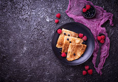 Pancakes with blueberries and raspberries. Selective focus Royalty Free Stock Image