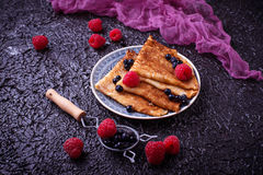 Pancakes with blueberries and raspberries. Selective focus Royalty Free Stock Photos