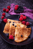 Pancakes with blueberries and raspberries. Selective focus Stock Photos