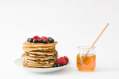 Pancakes with blueberries and raspberry isolated on white background Stock Image