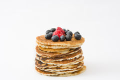 Pancakes with blueberries and raspberry isolated on white background Stock Photography