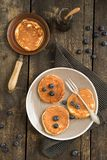 Pancakes with blueberries. And a small pan Stock Photos