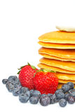 Pancakes, blueberries and strawberries Royalty Free Stock Photography