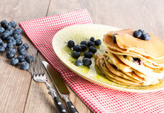 Pancakes. With blueberries on a table stock photography