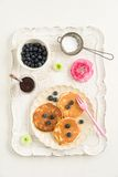 Pancakes with blueberries. On vintage tray Royalty Free Stock Photos