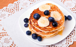Pancakes with blueberry and bananas Stock Photos