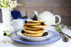 pancakes with blueberry on a blue plate stock photos